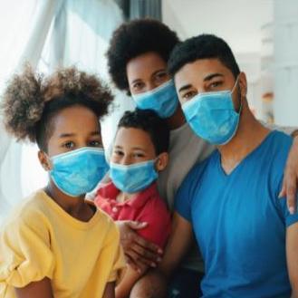 family wearing dust masks
